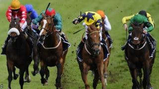 Our Channel, in the blue and yellow silks, wins the Derby Trial at Epsom
