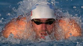 Michael Phelps finishes second to Ryan Lochte on competitive return