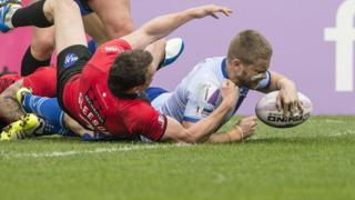 Rhys Hanbury scores one of his two tries at Salford