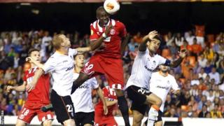 Stephane Mbia heads Sevilla's decisive goal in the semi-final with Valencia