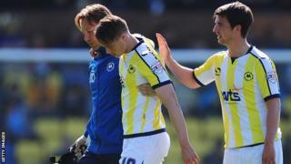 Billy Bodin limps off against Dagenham