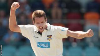 Glamorgan bowler Michael Hogan celebrates taking a wicket