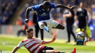 Doncaster Rovers's Dean Furman challenges Leicester City's Lloyd Dyer