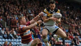 Castleford winger Kirk Dixon catches the ball under pressure from Huddersfield opposite number Aaron Murphy