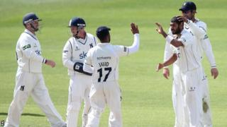 Warwickshire celebrate the wicket of Middlesex captain Chris Rogers at Edgbaston