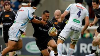 Sinoti Sinoti of Newcastle Falcons forces his way past Hoana Tui of Exeter Chiefs