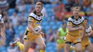 Castleford half-back Mark Sneyd scores one of his two second half tries as the Tigers mauled local rivals Wakefield Trinity Wildcats at the Etihad Stadium.