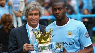 Manchester City manager Manuel pellegrini (left) midfielder Yaya Toure