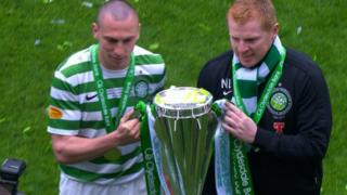 Neil Lennon holding the SPL trophy with Celtic captain Scott Brown