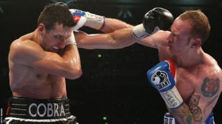 By the fifth round, Carl Froch had managed to draw George Groves out and the pair traded punches in the centre of the ring - the champion landing the heavier shots