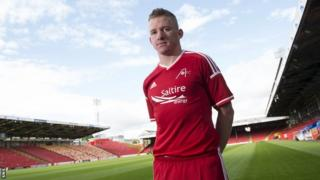 Aberdeen's Johnny Hayes models the new strip