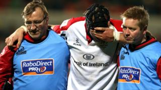 A distraught Stephen Ferris is helped off the pitch at Ravenhill after being injured during a Pro12 fixture against Edinburgh in November 2012