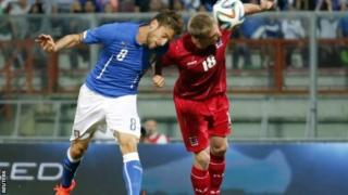 Italy's Claudio Marchisio (left) heads the ball to score against Luxembourg