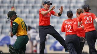 England celebrate a wicket against South Africa in the ICC Women's Twenty20 Cricket World Cup semi-final match in Dhaka, Bangladesh