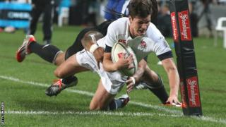 England's Freddie Burns is tackled by Ma'a Nonu