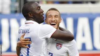 United States striker Jozy Altidore is congratulated by defender Fabian Johnson after scoring against Nigeria