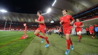 Wales players enter the field to warm-up at the Nelson Mandela Bay Stadium in Port Elizabeth ahead of the opening game of their South Africa tour against EP Kings.