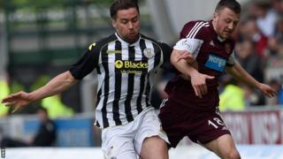 Darren McGregor eases Hearts' Dale Carrick off the ball