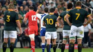 Wales centre Jamie Roberts is yellow carded for tackling Willie le Roux in the air