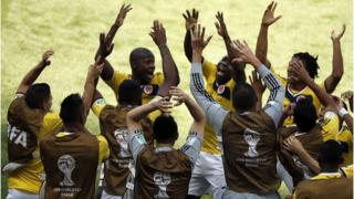 Colombia celebrate their first goal during a 3-0 win over Greece