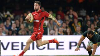 Alex Cuthbert runs in to score a memorable late consolation try for Wales.