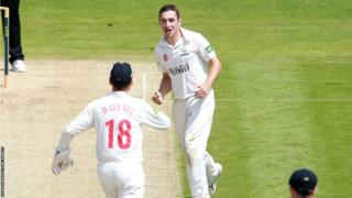 Andrew Salter celebrates after Daniel Bell-Drummond was caught by Ben Wright off his bowling on the opening day of Glamorgan's County Championship match against Kent.