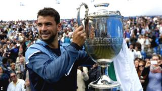 Grigor Dimitrov with the trophy at Queen's