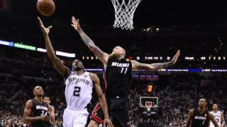 San Antonio Spurs forward Kawhi Leonard goes to the basket