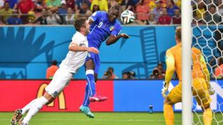 Italy's Mario Balotielli heads the winner past England's Joe Hart