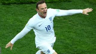 England striker Wayne Rooney celebrates equalising against Uruguay