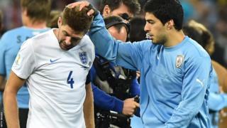 World Cup 2014: Steven Gerrard is consoled by Uruguay's forward Luis Suarez after defeat in the Group D match between Uruguay and England