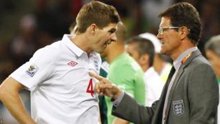 Fabio Capello talks with England team captain Steven Gerrard during the Fifa World Cup 2010 group C preliminary round match between England and Algeria