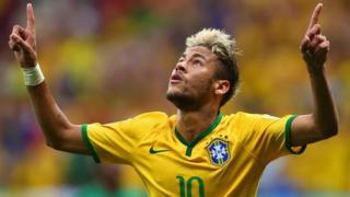 Brazil's Neymar celebrates goal against Cameroon