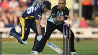 Glamorgan's Stewart Walters survives a run out attempt from Surrey's Robin Peterson