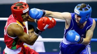 Delhi 2010: Sean McGoldrick (on the right) was beaten by Manju Wanniarachchi in the bantamweight final but was later awarded gold after the Sri Lankan failed a drugs test.