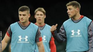 Rhys Priestland makes a point to Scott Williams during a Wales training session