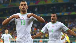 A controversial equaliser from Islam Slimani was enough to secure Algeria qualification for the last 16