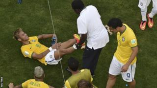 Brazil playmaker Neymar gets some treatment during his side's win over Chile