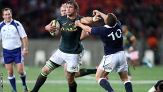 Duane Vermeulen brushes Scotland's Duncan Weir aside during the weekend Test