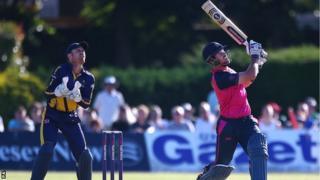Glamorgan keeper Mark Wallace looks on Middlesex batsman Danny Christian hoists a high one against Glamorgan at Richmond