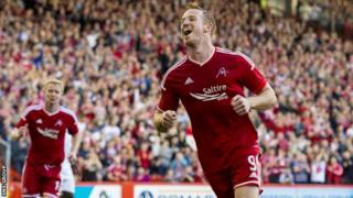 Adam Rooney scored twice in a comfortable win for Aberdeen at Pittodrie