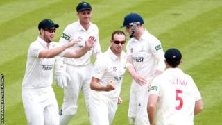 Glamorgan players celebrate taking a wicket against Kent.