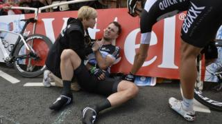 Cavendish gets treatment on the side of the road, his right shoulder clearly giving him a lot of discomfort
