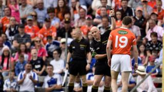 Finnian Moriarty receives a black card during the first half of the match at Clones