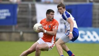 Eugene McVerry wheels away from Vinny Corey as Monaghan secure their place against Donegal in the Ulster final