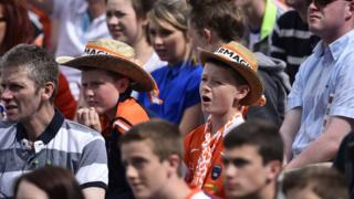 Some young supporters show their colours at the semi-final replay