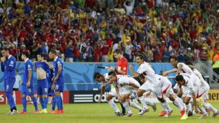 Costa Rica's players celebrate after the deciding goal during a penalty shootout in their 2014 World Cup round of 16 game against Greece at the Pernambuco Arena in Recife