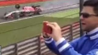 A tyre from Kimi Raikkonen's Ferrari narrowly misses Max Chilton's Marussia at Silverstone