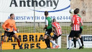Michael Duffy scores Derry City's first goal against Aberystwyth
