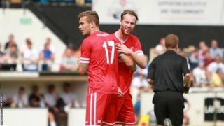 Jo Inge Berget (right) is congratulated by Joe Ralls after giving Cardiff City the lead in the 1-1 draw against Bath City